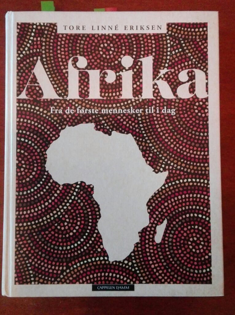 Omslaget til boka Afrika, fra de første mennesker til i dag, av Tore Linné Eriksen. Omslaget viser omrisset av det afrikanske kontinentet.